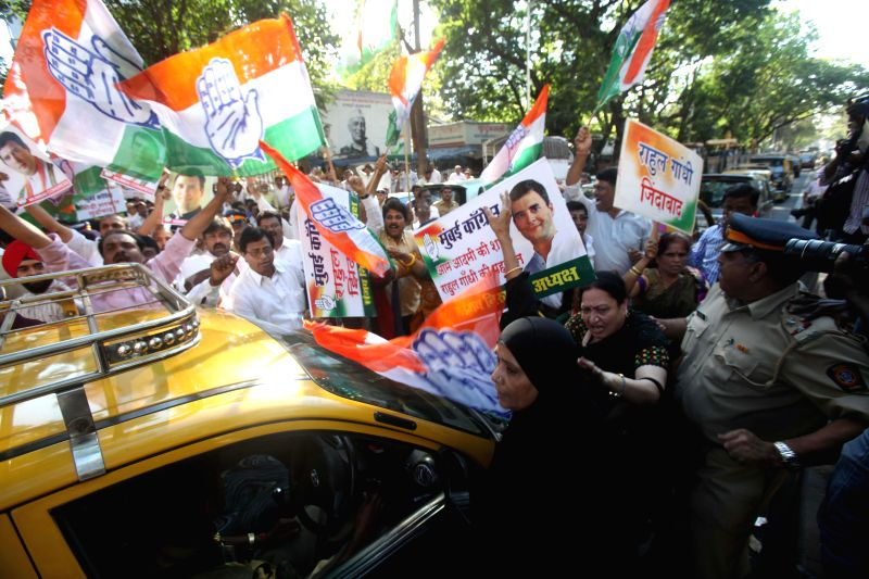 Congress workers stage a protest against the profiling of Rahul Gandhi that was conducted by the Delhi Police recently in Mumbai, on March 16, 2015.
