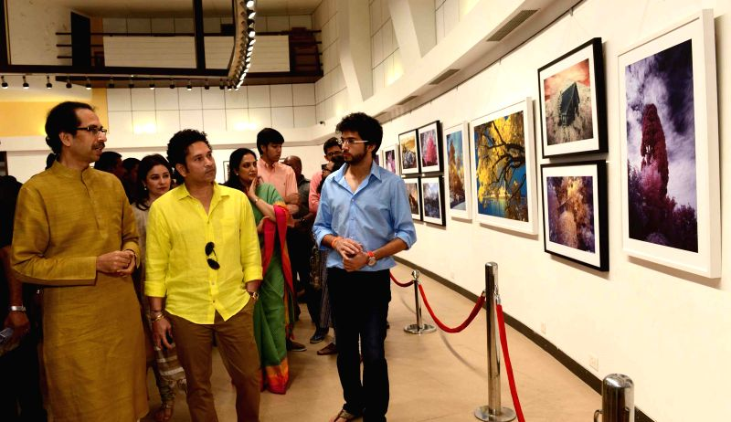 Cricket legend Sachin Tendulkar at the photography exhibition of Shiv Sena Chief Uddhav Thackeray, organised to raise funds for drought affected farmers, in Mumbai, on Jan 11, 2015. Also seen - Sachin Tendulkar
