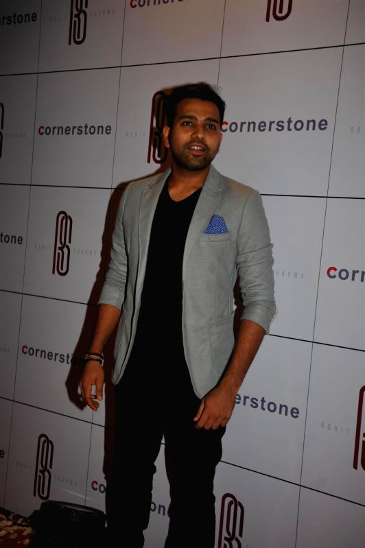 Cricketer Rohit Sharma arrives for his felicitation ceremony on his world-record double century in Mumbai, on Nov 20, 2014.
