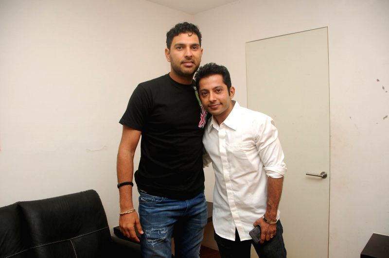 Cricketer Yuvraj Singh with Rajeev Sharma during the Cancer awareness event on the occasion of International Women`s Day by Savitri Pratishthan in Mumbai, on March 8, 2015. - Yuvraj Singh and Rajeev Sharma