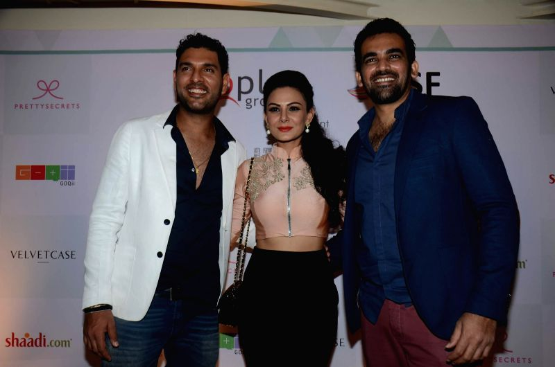 Cricketers Yuvraj Singh and Zaheer Khan with Anchal Kumar during their Evolve Digital India fashion show in Mumbai on Feb 27, 2015. - Yuvraj Singh, Zaheer Khan and Anchal Kumar
