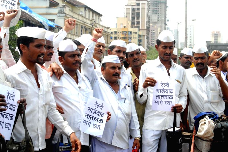 Mumbai Dabbewala protest against rail fare hike at Lower Parel in Mumbai on June 21, 2014.