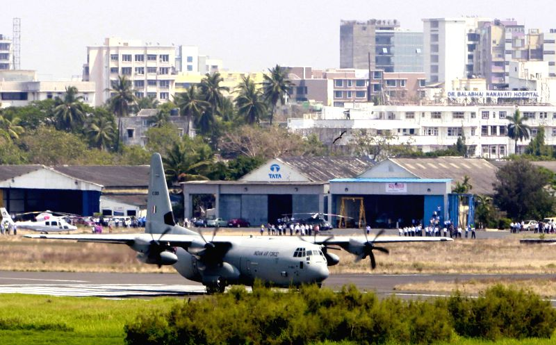 Defence cargo aircraft Hercules C130J lands at the Juhu Airport in Mumbai on March 24, 2015.