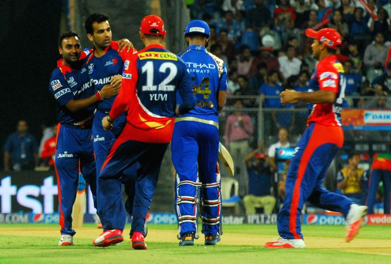 Delhi Daredevils celebrate fall of Lendl Simmons' wicket during an IPL 2015 match between Mumbai Indians and Delhi Daredevils at the Wankhede Stadium in Mumbai on May 5, 2015.
