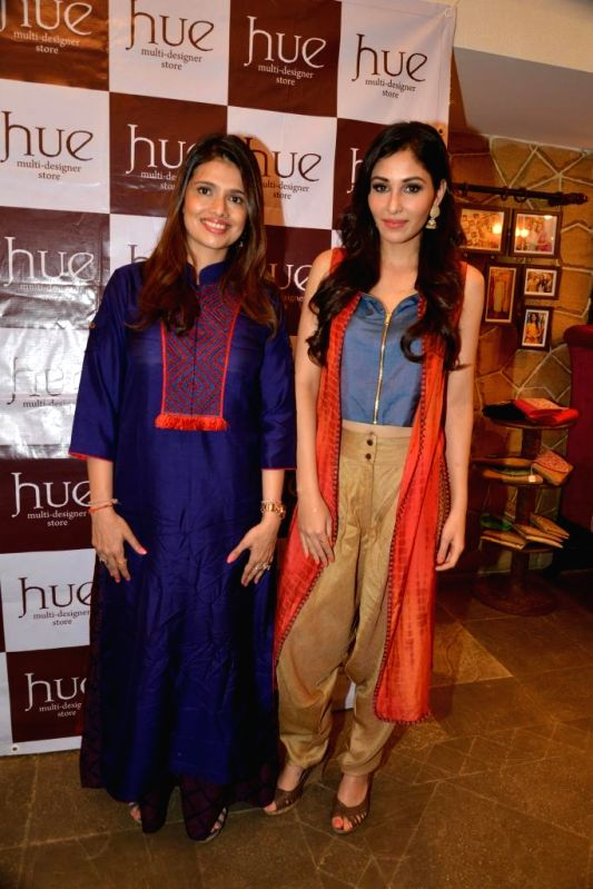 Designer Shruti Sancheti and Pooja Chopra during the launch of Spring Summer Collection 2015 by designers Tamanna Punjabi Kapoor and Shruti Sanchet in Mumbai, on March 13, 2015. - Pooja Chopra and Tamanna Punjabi Kapoor