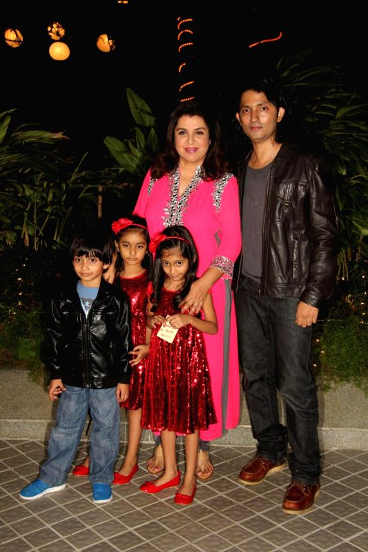 Director and choreographer Farah Khan with husband Shirish Kunder during the birthday party of Farah Khan in Mumbai, on jan. 08, 2015.