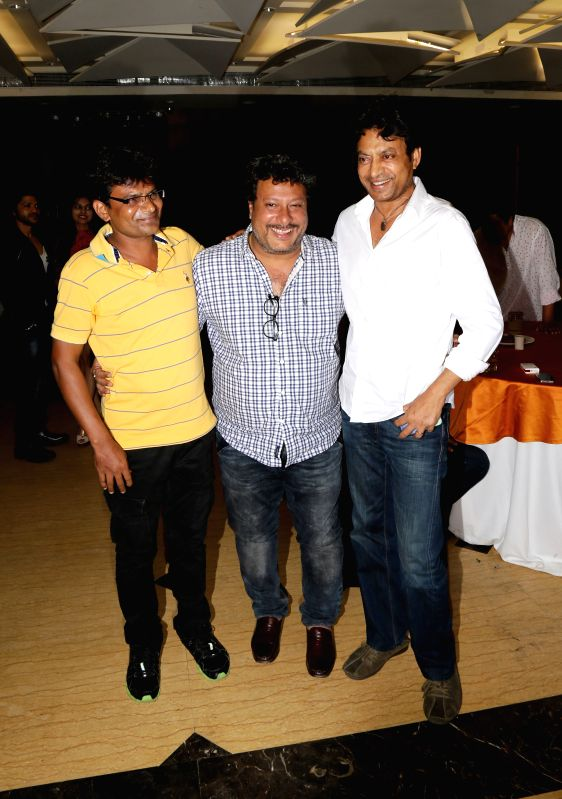 Director and producer Irshad Khan with Tigmanshu Dhulia and Irrfan Khan during the film Bumper Draw completion party in Mumbai on April 26, 2015. - Irshad Khan and Irrfan Khan