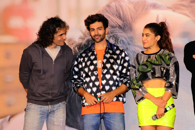 "Mumbai: Director Imtiaz Ali with actors Sara Ali Khan and Kartik Aaryan at the trailer launch of their upcoming film ""Love Aaj Kal"" in Mumbai on Jan 17, 2020. (Photo: IANS)"