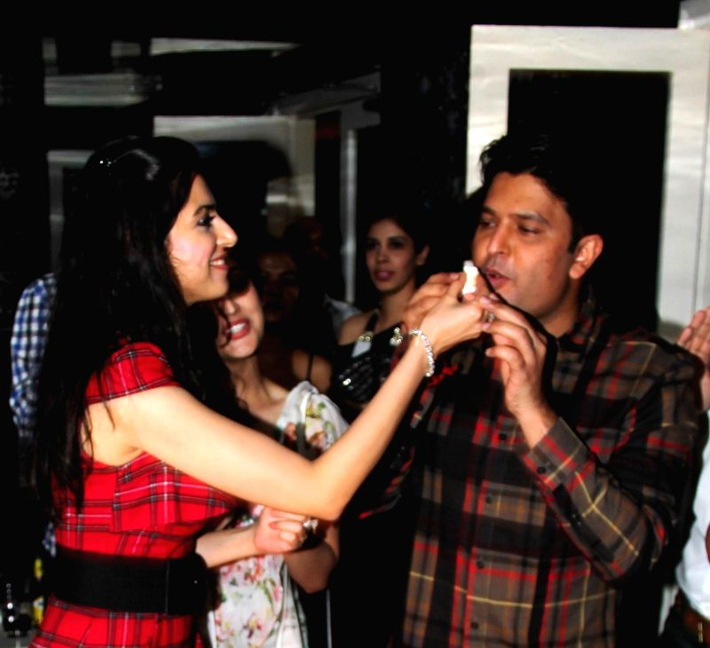 Divya gives cake to Bhushan at Divya`s birthday bash in Mumbai, on November 20, 2014.