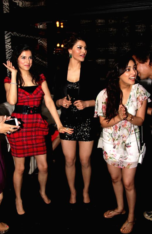 Divya Khosla Kumar, Urvashi Rautela and Yami Gautam shake a leg at Divya`s birthday bash in Mumbai, on November 20, 2014.
