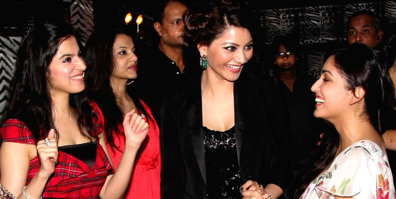 Divya Khosla Kumar, Urvashi Rautela and Yami Gautam share a moment at Divya`s birthday bash in Mumbai, on November 20, 2014.