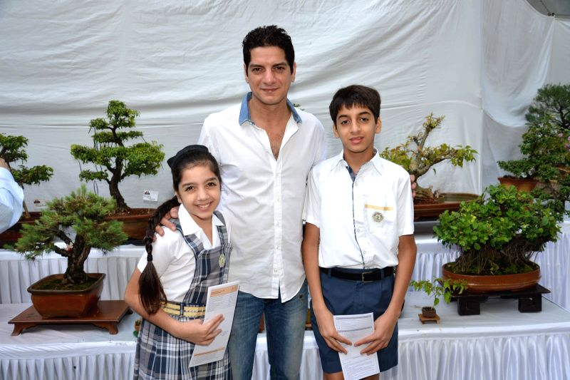 Dj Aqueel with kids during the Inauguration of Exotic Bonsai and Ikebana Exhibition in Mumbai on Feb 27, 2015.