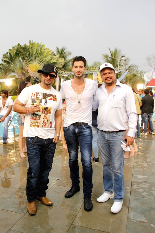 Dj Sheizwood, with Sunny Leone's husband Daniel Weber, Dinesh Tiwari (Director) during the press conference of film Dangerous Husn in Mumbai on March 27, 2015.