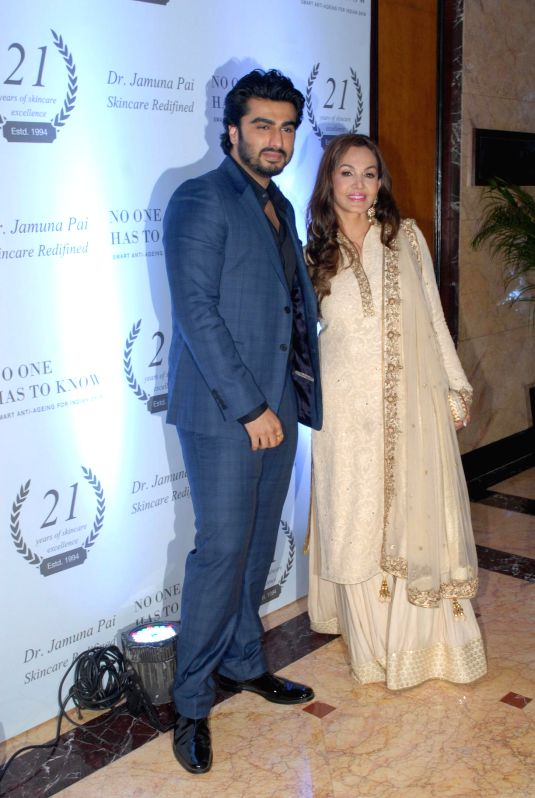 Dr Jamuna Pai and actor Arjun Kapoor during the launch of Dr Jamuna Pai's book No One Has to Know, the ultimate skin care and Anti Ageing Guide in Mumbai, on Jan 27, 2015. - Arjun Kapoor