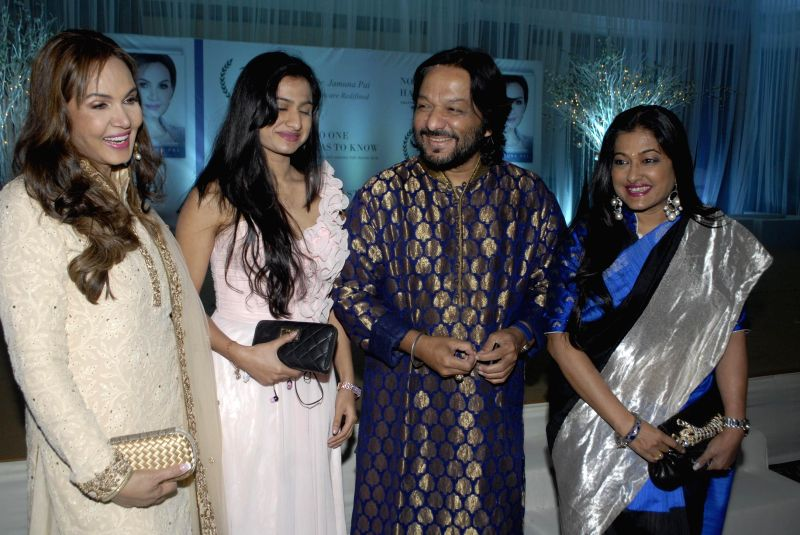 Dr Jamuna Pai, singer Roop Kumar Rathod along with his wife Sunali and daughter Reeva during the launch of Dr Jamuna Pai's book No One Has to Know, the ultimate skin care and Anti Ageing ... - Roop Kumar Rathod