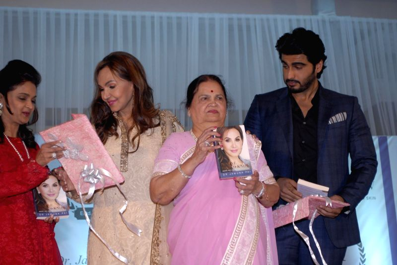 Dr Jamuna Pai with Kokilaben Ambani and actor Arjun Kapoor during the launch of Dr Jamuna Pai's book No One Has to Know, the ultimate skin care and Anti Ageing Guide in Mumbai, on Jan 27, ... - Arjun Kapoor and Kokilaben Ambani