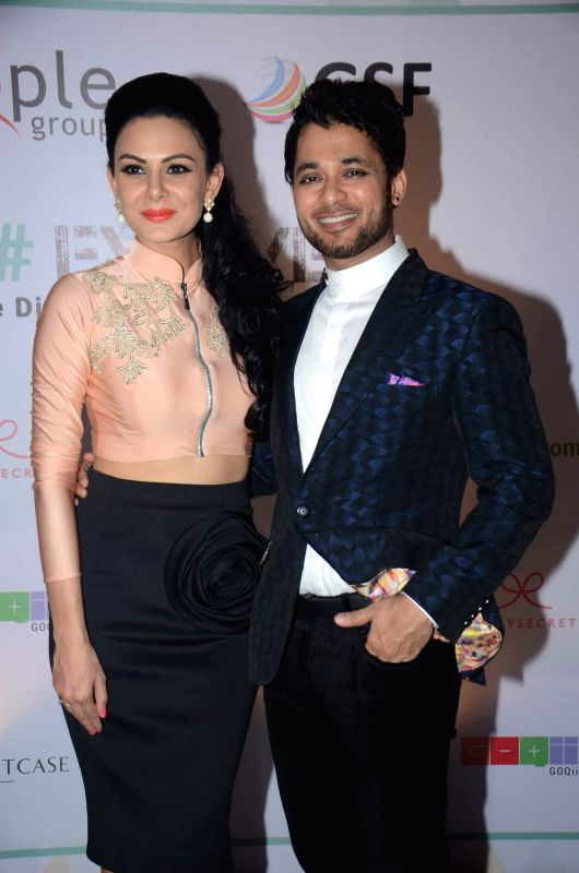 Fashion designer Anchal Kumar and Anupam Mittal during their Evolve Digital India fashion show in Mumbai on Feb 27, 2015. - Anchal Kumar