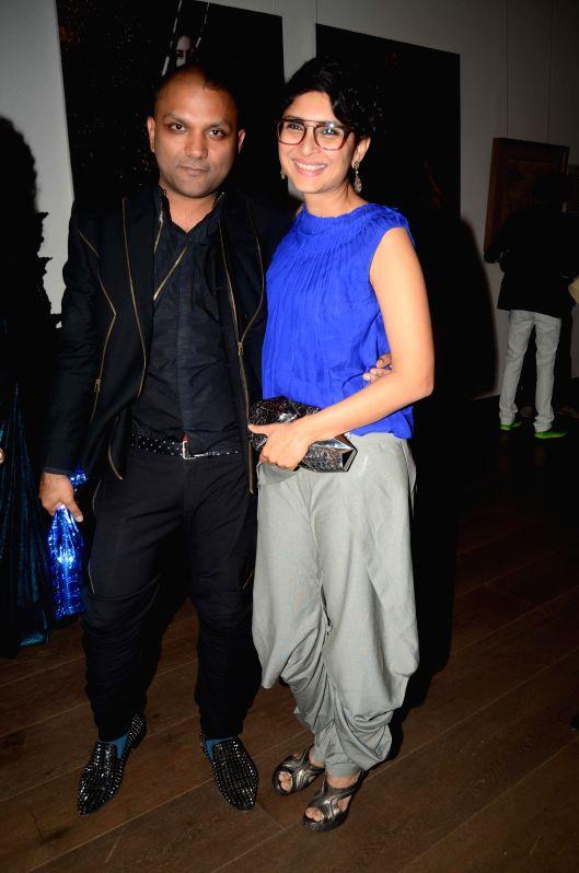 Fashion designer Gaurav Gupta with filmmaker Kiran Rao during the opening of his store in Mumbai on Nov 27, 2014. - Kiran Rao