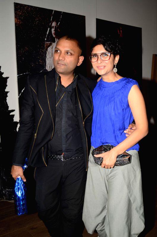 Fashion designer Gaurav Gupta with Bollywood filmmaker Kiran Rao during the opening of his store in Mumbai on Nov 27, 2014. - Kiran Rao
