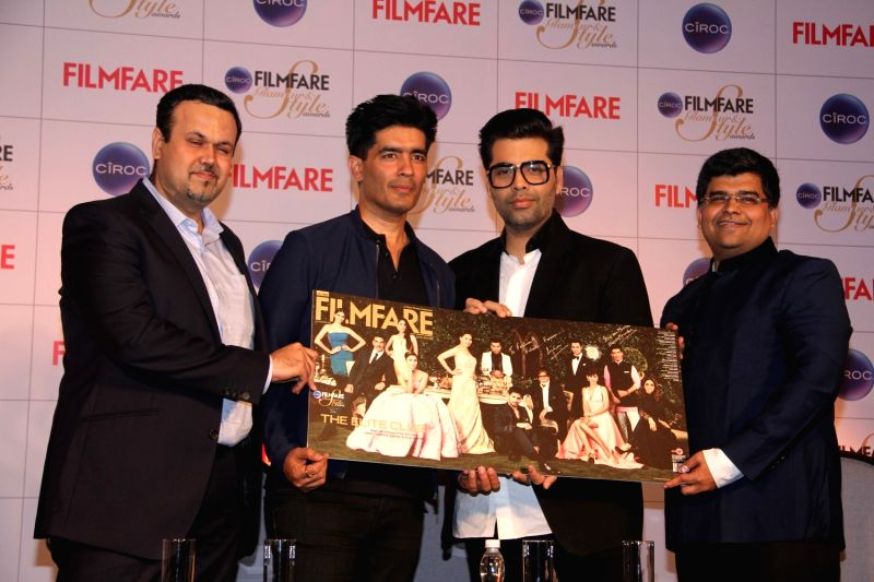 Fashion designer Manish Malhotra, Bhavesh Somaya, Marketing and Innovation Director, Diageo India, filmmaker Karan Johar and Filmfare editor Jitesh Pillai during the cover launch of Ciroc ... - Karan Johar and Manish Malhotra