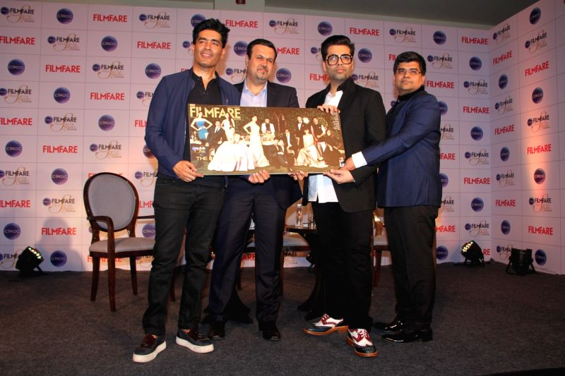 Fashion designer Manish Malhotra, Bhavesh Somaya, Marketing and Innovation Director, Diageo India, filmmaker Karan Johar and Filmfare editor Jitesh during the cover launch of Ciroc Filmfare ... - Karan Johar and Manish Malhotra