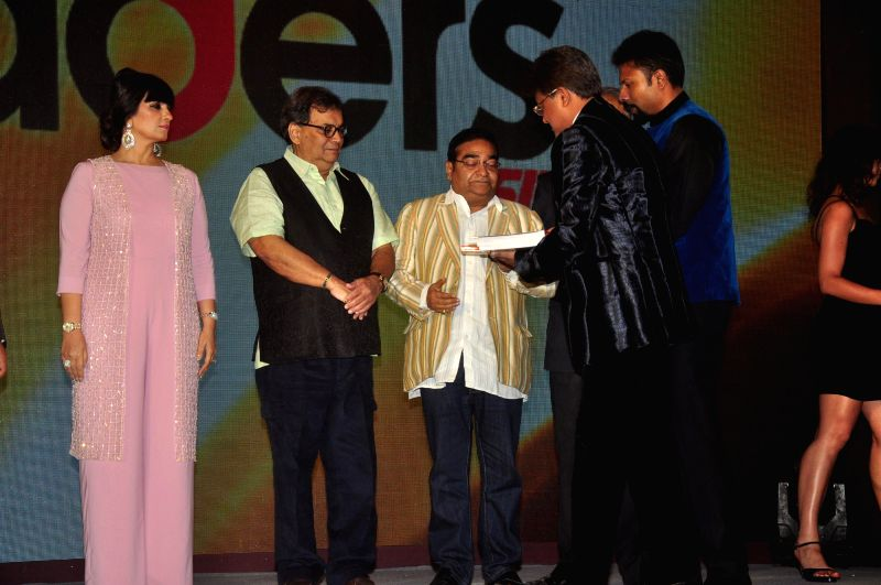 Fashion designer Neeta Lulla and filmmaker Subhash Ghai during Pride of India Awards in Mumbai, on Dec. 16, 2014.