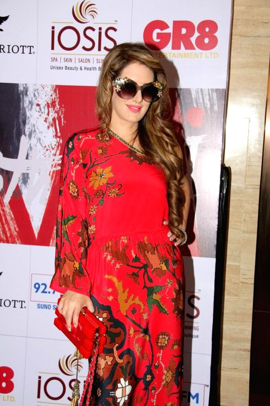 Fashion designer Pria Kataria Puri during the charity event, Be with Beti, to celebrate International Women`s Day, in Mumbai, on March 8, 2015.