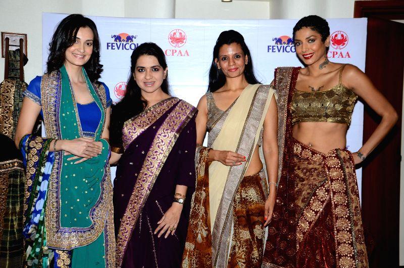 Fashion designer Shaina NC with models Vaishali Desai, Preeti Rathi Gupta and Diandra Soares during the preview of fashion designer Shaina NC at the Pidilite 10th Caring with Style fashion ... - Vaishali Desai and Preeti Rathi Gupta