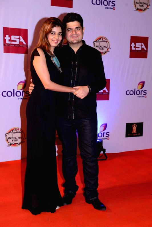 Fashion photographer Dabboo Ratnani with his wife Manisha during the Television Style Award 2015 in Mumbai, on March 13, 2015.