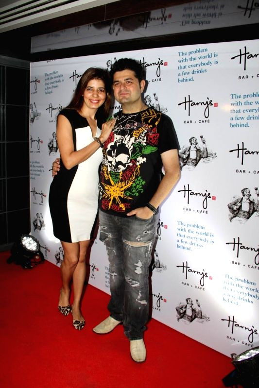 Fashion photographer Daboo Ratnani with his wife Manisha during the launch of Harry`s Bar in Mumbai, on March 19, 2015.