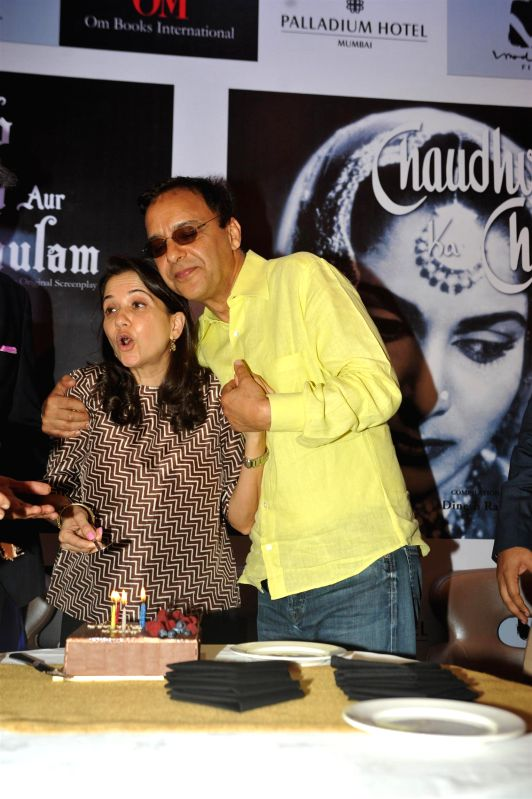Film Critic Anupama Chopra celebrates her birthday with husband filmmaker Vidhu Vinod Chopra at the launch of filmmaker Guru Dutt's film screenplays books in Mumbai on Feb 23, 2015. - Critic Anupama Chopra and Dutt