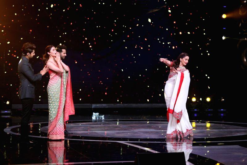 "Mumbai: Film ""Kalank"" actors Madhuri Dixit, Alia Bhatt and Varun Dhawan on the sets of ""Sa Re Ga Ma Pa Lil Champs"", in Mumbai, on April 16, 2019. (Photo: IANS)"