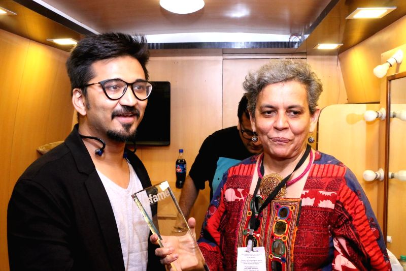 Filmmaker Amit Trivedi and Artist Brinda Miller during the closing ceremony of Kala Ghoda festival in Mumbai on Feb 15, 2015. - Amit Trivedi