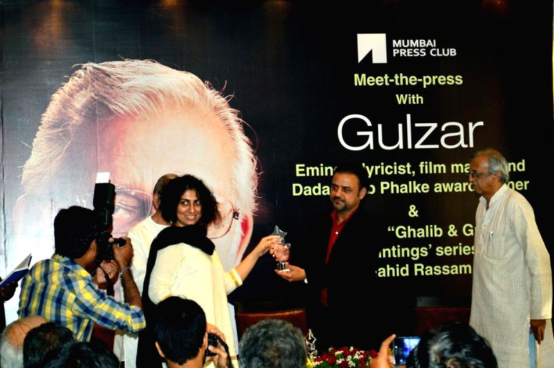 Filmmaker and lyricist Gulzar during the launch of painting series Ghalib & Gulzar, a paintings series by Pakistani artist Shahid Rassam in Mumbai on Feb. 4, 2015. - Shahid Rassam
