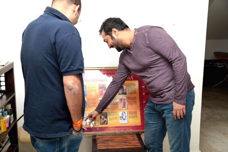 Filmmaker Anurag Kashyap during the launch of calendar `The Beginnings of Indian Cinema 2015` full of rare posters of the earliest films made in India, in Mumbai.