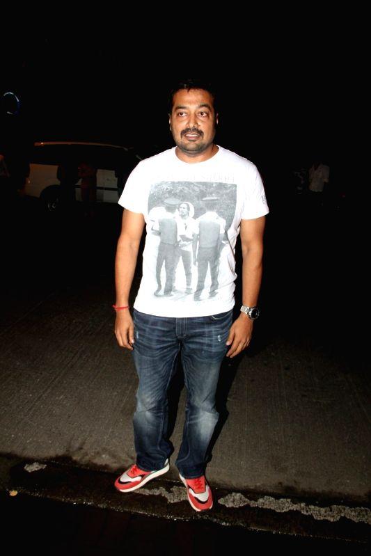 Filmmaker Anurag Kashyap leaves after attending a get-together at actor Farhan Akhtar`s home, in Mumbai on April 10, 2015. - Anurag Kashyap