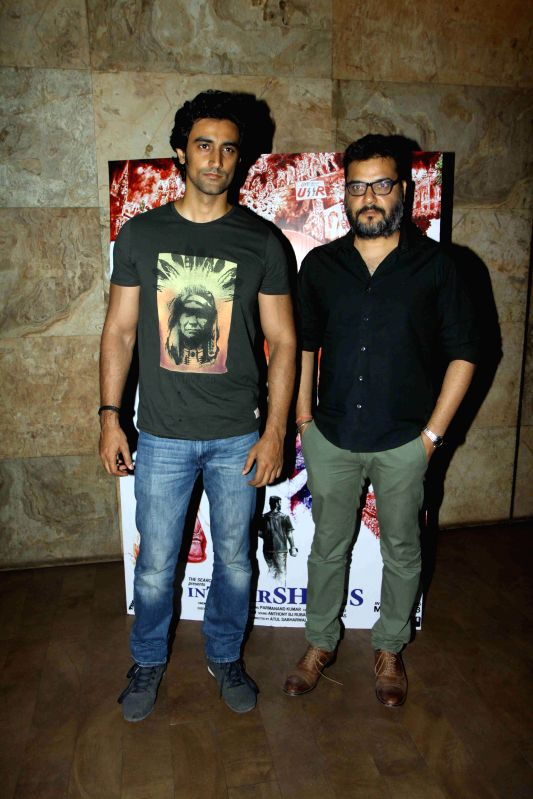 Filmmaker Atul Sabhaewal and actor Kunal Kapoor during the screening of film In Their Shoes in Mumbai, on March 10, 2015. - Atul Sabhaewal and Kunal Kapoor