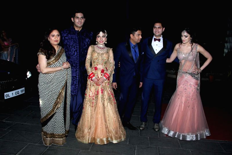 Filmmaker Bhushan Kumar with his family during the wedding reception of Tulsi Kumar and Hitesh in Mumbai on March 2, 2015. - Bhushan Kumar