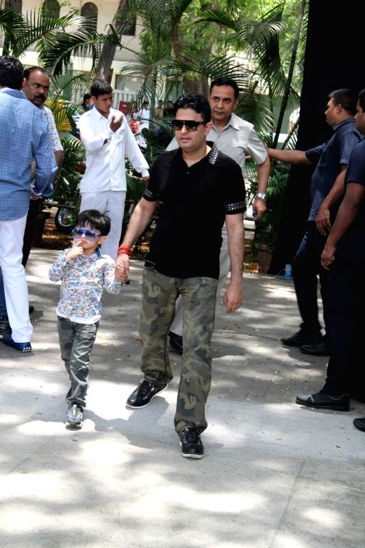 Filmmaker Bhushan Kumar with his son during the promotion of film Dil Dhadakne Do in Mumbai, on May 3, 2015. - Bhushan Kumar