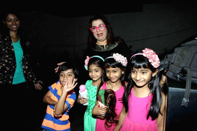 Filmmaker Farah Khan along with her children during the special screening of film Cinderella in Mumbai on March 13, 2015. - Farah Khan
