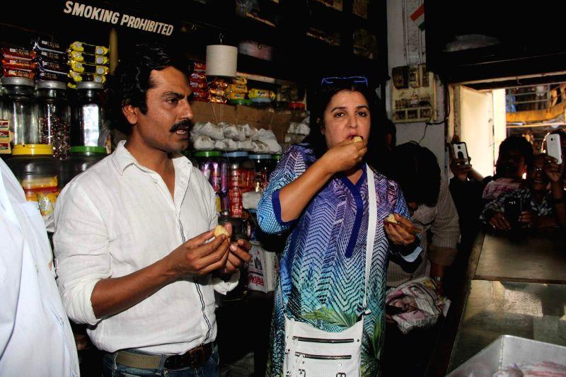 Filmmaker Farah Khan and actor Nawazuddin Siddiqui during the launch of Ritesh Batra`s `Poetic License` at Irani Cafe, in Mumbai on April 4, 2015. - Farah Khan and Nawazuddin Siddiqui