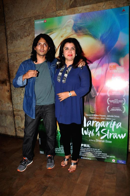 Filmmaker Farah Khan with her husband Shirish Kunder during the special screening of film Margarita With A Straw in Mumbai on 13th April 2015. - Farah Khan