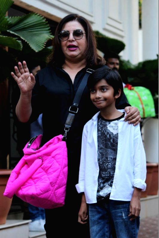Mumbai: Filmmaker Farah Khan with her son Czar Kunder  during birthday celebrations of actress Shilpa Shetty's son Viaan in Mumbai on May 25, 2019.