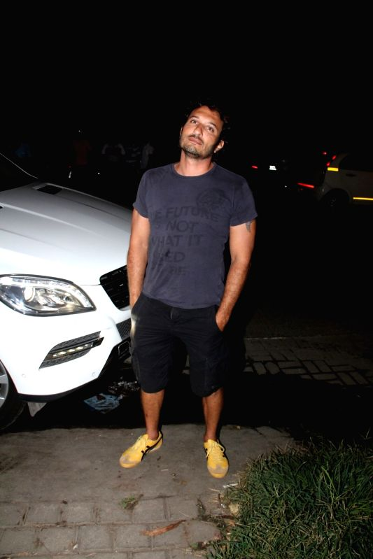 Filmmaker Homi Adajania leaves after attending a get-together at actor Farhan Akhtar`s home, in Mumbai on April 10, 2015. - Homi Adajania