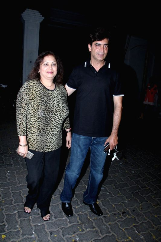 Filmmaker Indra Kumar and his wife arrive for actor Anil Kapoor`s get-together to share the trailer of the film Dil Dhadakne Do, in Mumbai on 13th April 2015. - Indra Kumar