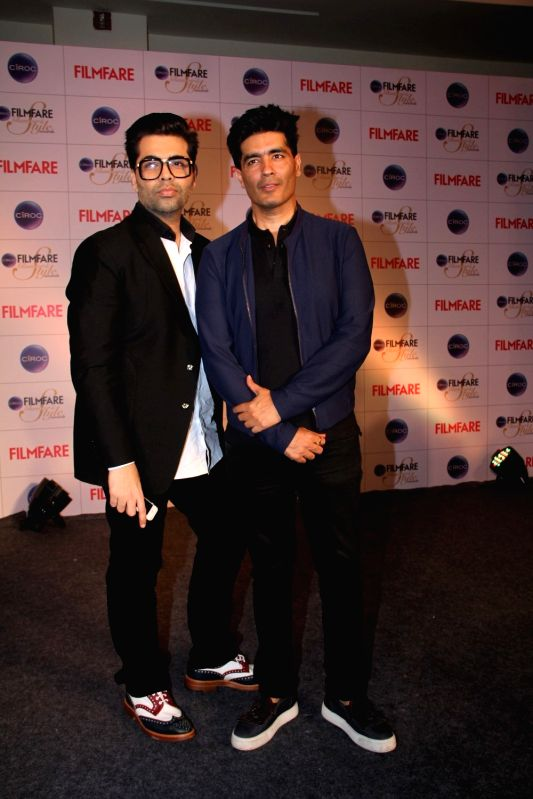 Filmmaker Karan Johar and fashion designer Manish Malhotra during the cover launch of Ciroc Filmfare Glamour and Style Awards issue in Mumbai on March 30, 2015. - Karan Johar and Manish Malhotra