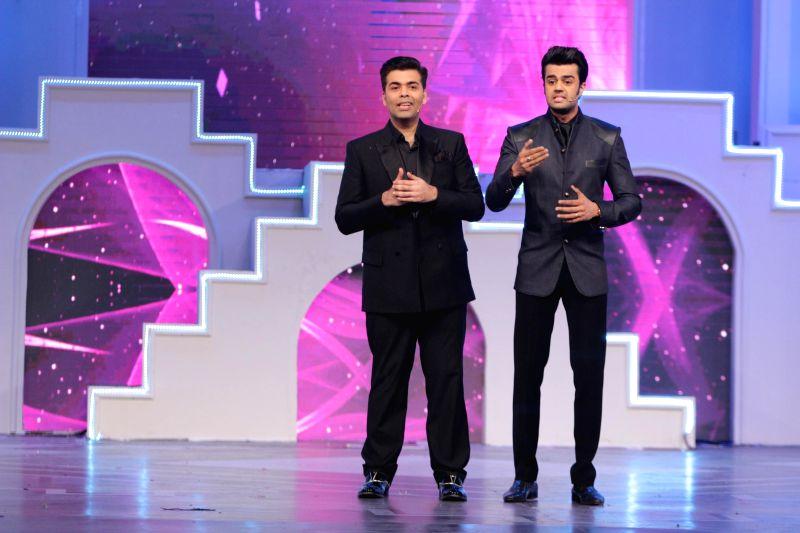 Filmmaker Karan Johar and Manish Paul during the Television Style Award 2015 in Mumbai, on March 13, 2015. - Karan Johar