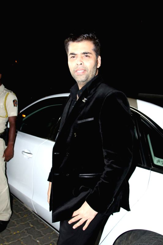 Filmmaker Karan Johar arrive for actor Anil Kapoor`s get-together to share the trailer of the film Dil Dhadakne Do, in Mumbai on 13th April 2015. - Karan Johar