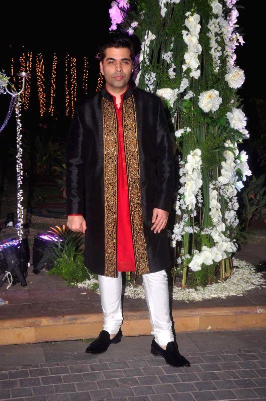 Filmmaker Karan Johar during Riddhi Malhotra and Tejas Talwalkar's sangeet ceremony in Mumbai, on December 13, 2014. - Karan Johar
