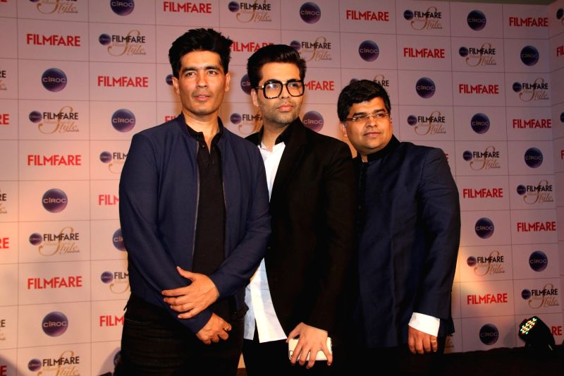 Filmmaker Karan Johar, fashion designer Manish Malhotra and Filmfare editor Jitesh Pillai during the cover launch of Ciroc Filmfare Glamour and Style Awards issue in Mumbai on March 30, 2015. - Karan Johar and Manish Malhotra